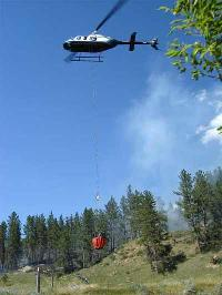 Photograph of a Bell 206L-I helicopter with Bambi Bucket Long Line